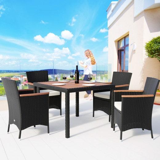 Salotto da giardino Korfu con piano tavolino legno acacia e sedie impilabili 9 pezzi nero polyrattan